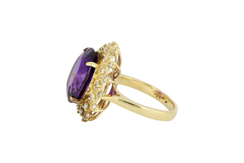 14ct gold cluster ring set with amethyst surrounded by diamonds