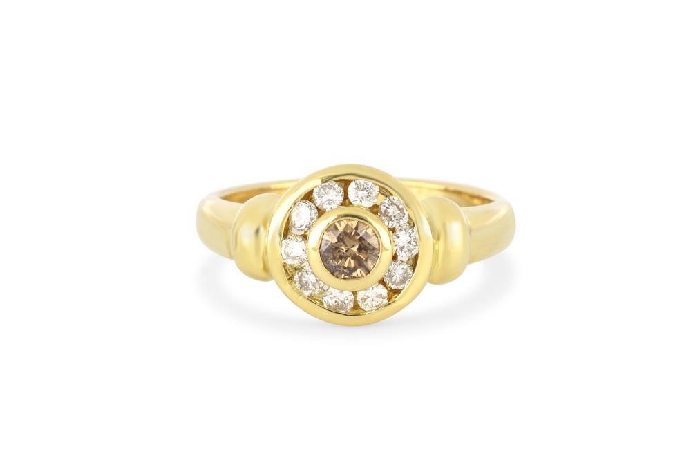 18k yellow gold ring set with cognac & white diamonds