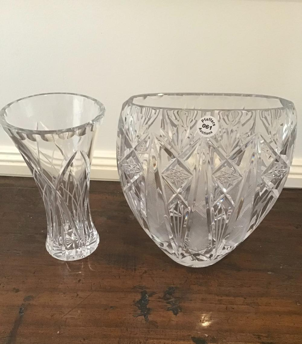 Two very heavy cut crystal vases 20 cms tall