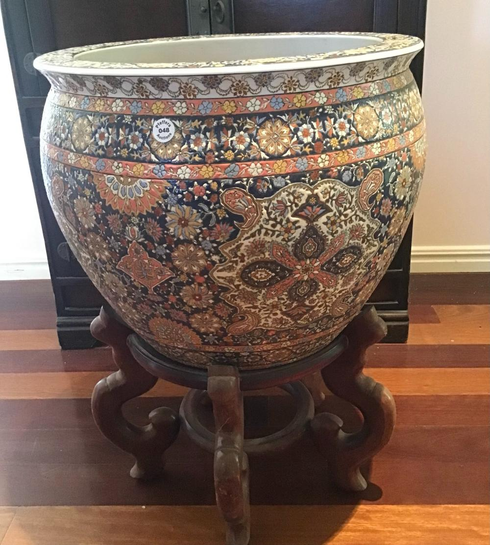 Large vintage Chinese hand painted floral design over glazed porcelain fish bowl on timber stand