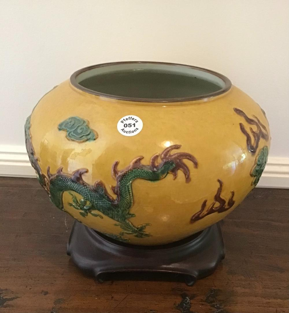 Large vintage Chinese over glazed porcelain bowl with dragon on a yellow ground
