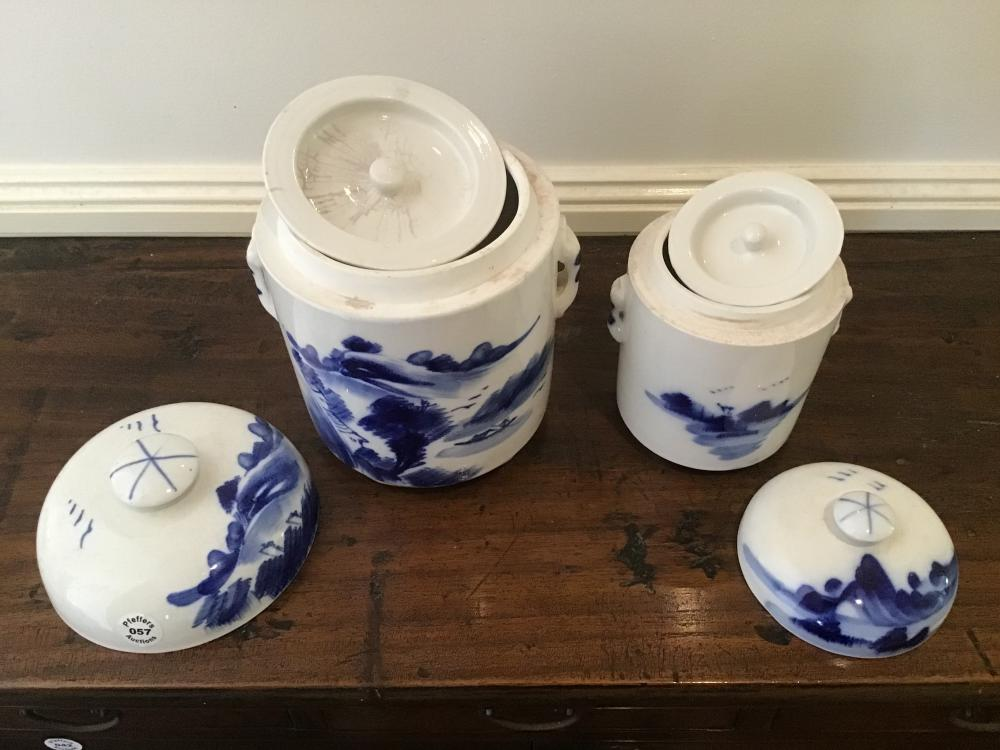 Two Chinese hand painted under glazed blue and white jars with lids
