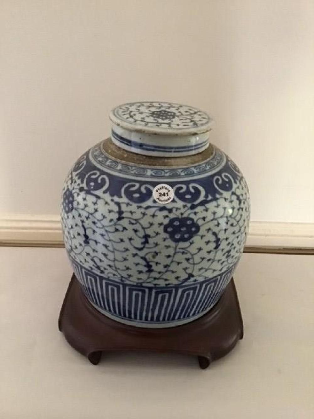 Antique Chinese blue and white underglaze porcelain lidded jar on wood stand 27 cms tall