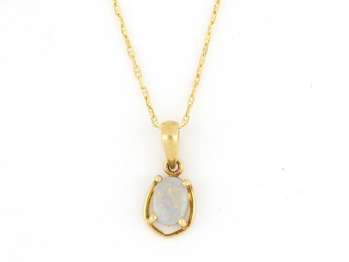 18ct gold opal pendant on 9ct gold chain