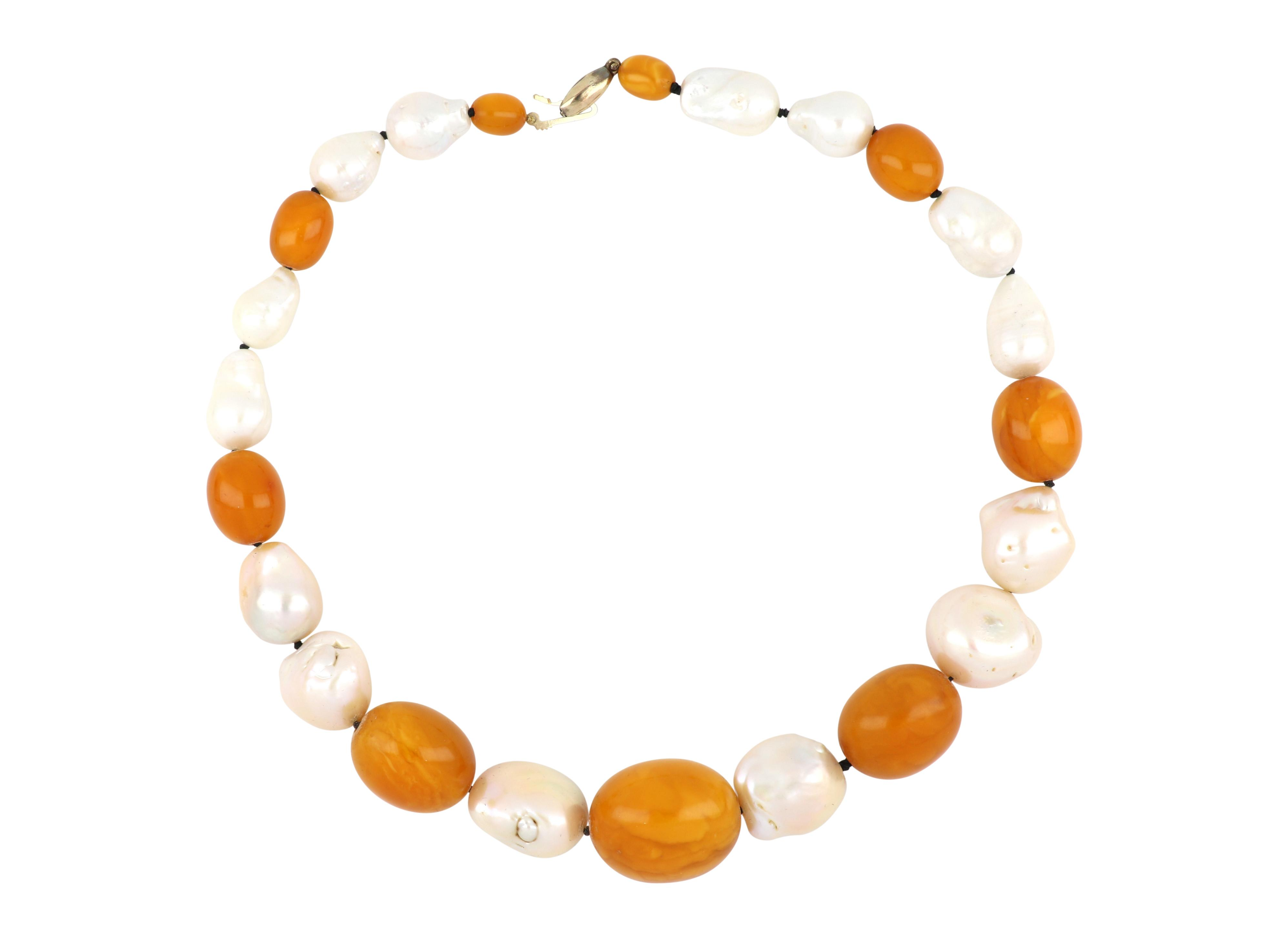 Antique Baltic Butterscotch amber and pearl necklace, Beads graduate from 25mm to 5mm measured across the beads, Necklace 45 cms long, Weight 93.00 grams