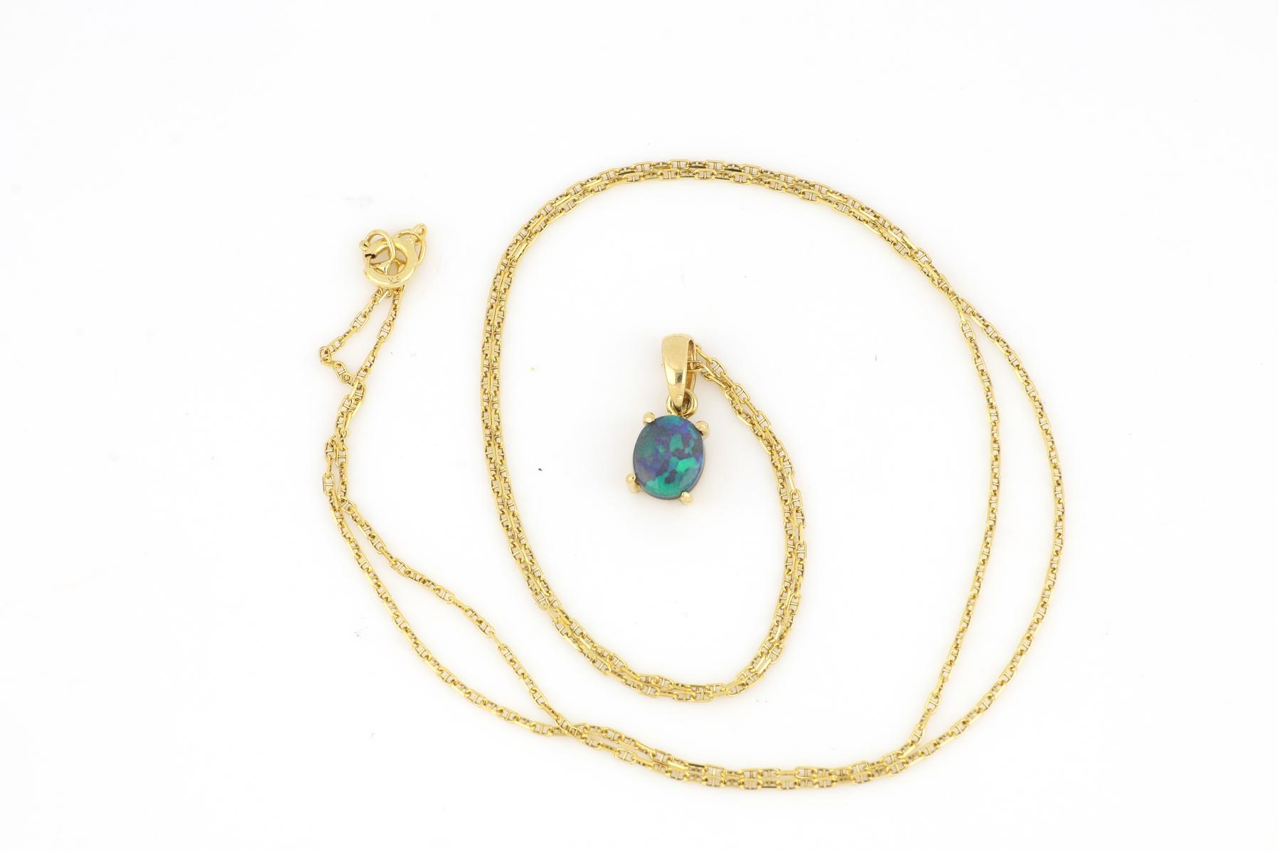 18ct yellow old opal pendant on 9ct gold neck chain