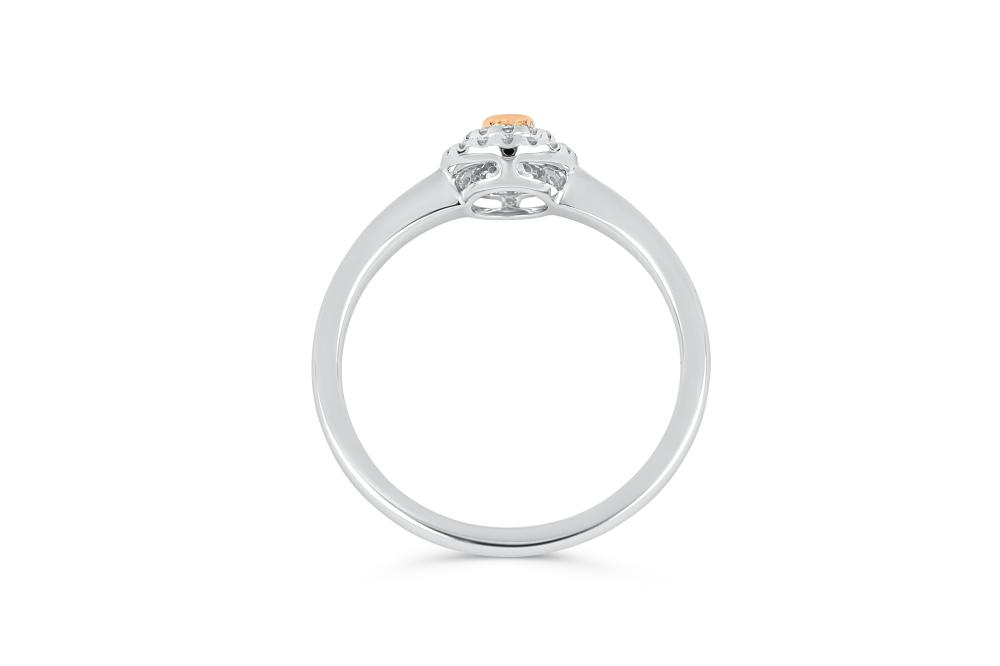 18k gold ring set with a centre FP Argyle 0.058ct oval cut natural diamond