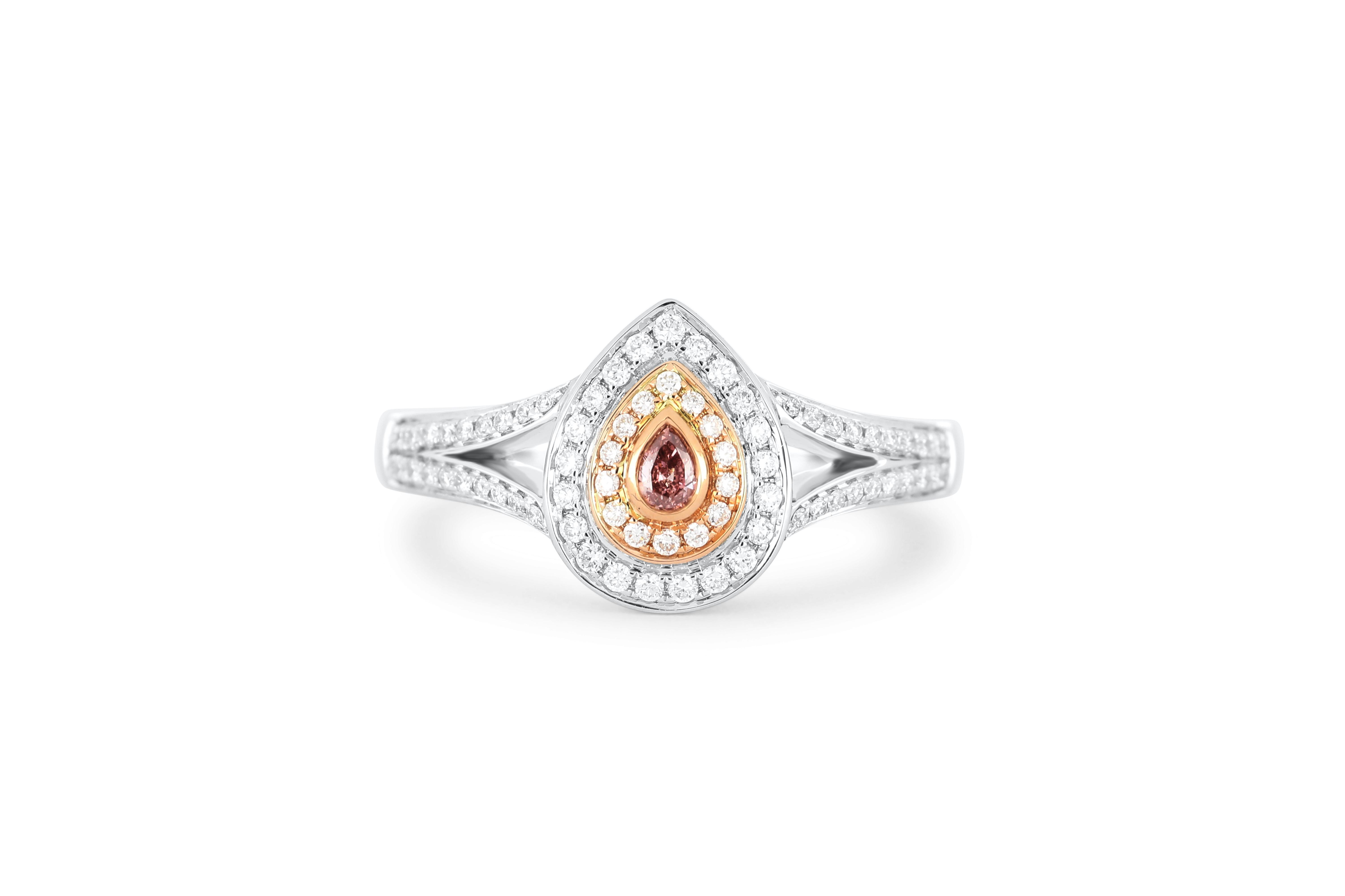 18k gold ring set with a centre FDPR Argyle 0.04ct pear cut natural diamond