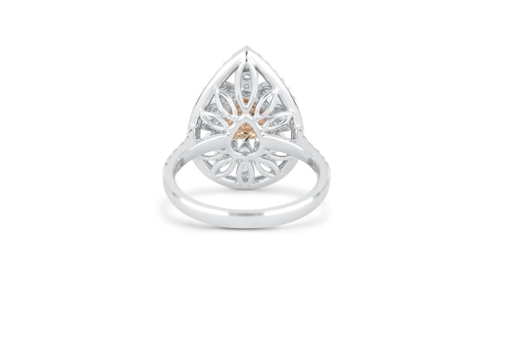 18k gold ring set with a FPP Argyle 0.162ct pear cut natural diamond