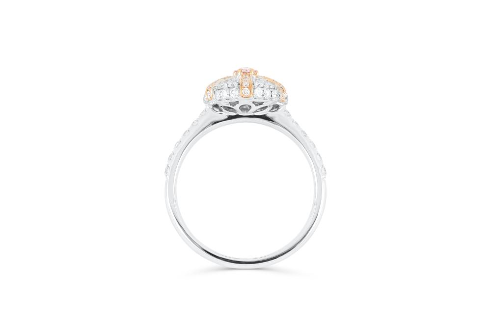 18k gold ring set with a centre FP Argyle 0.096ct oval cut natural diamond