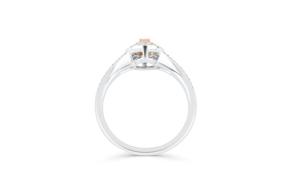 18k gold ring set with a centre FP Argyle 0.097ct oval cut natural diamond
