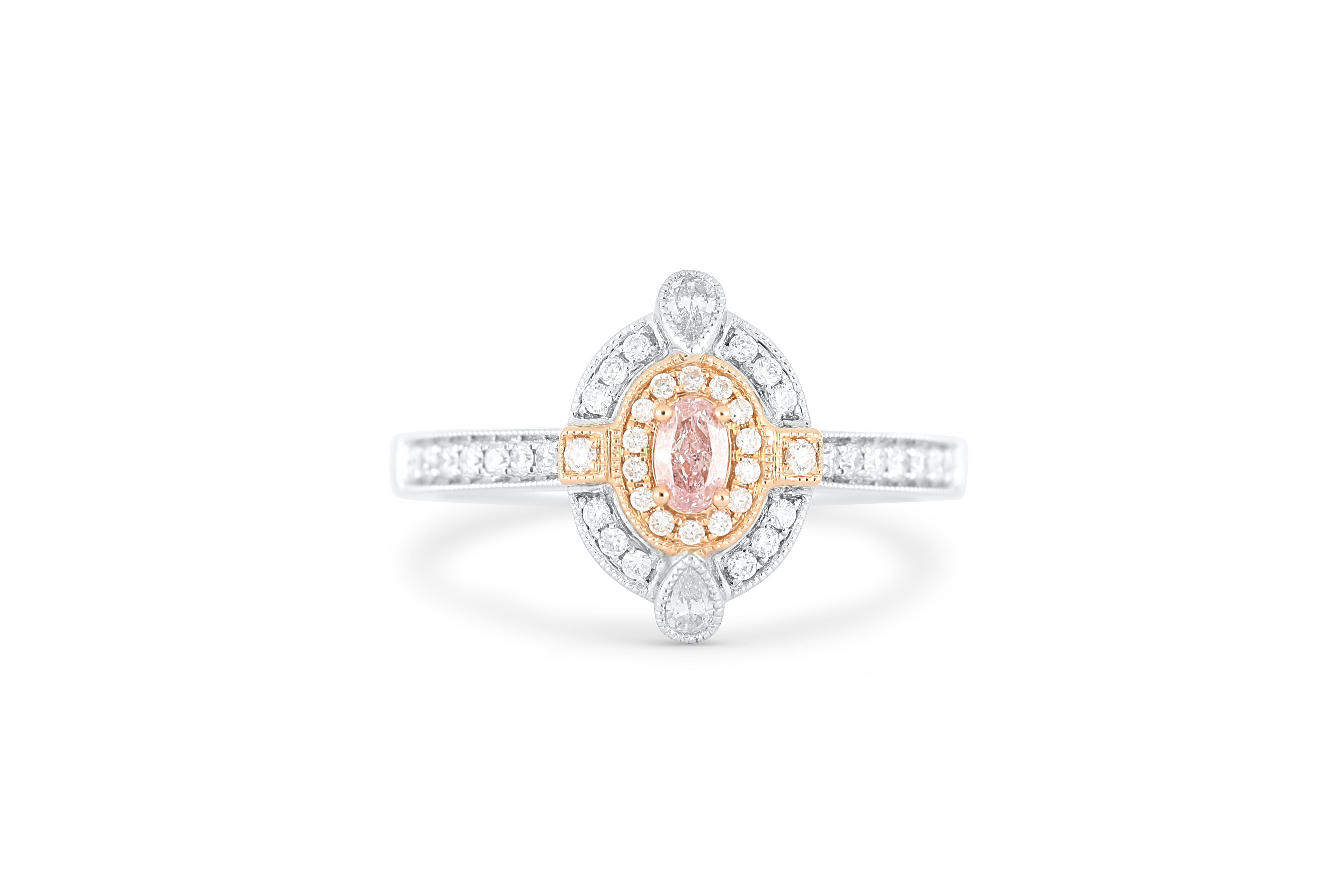 18k gold ring set with a centre FP Argyle 0.118ct oval cut natural diamond