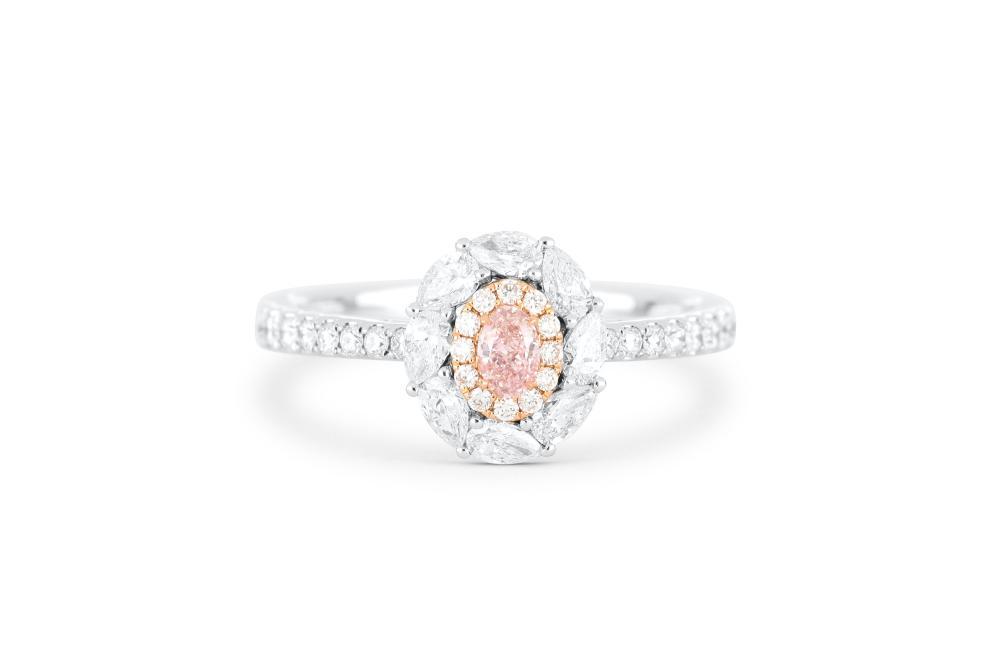 18k gold ring set with a centre FLP Argyle 0.131ct oval cut natural diamond