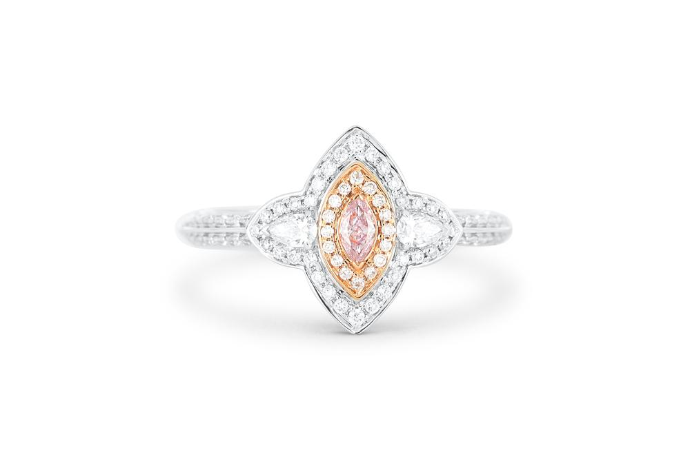 18k gold ring set with a centre FLPP 0.07ct marquise cut natural diamond
