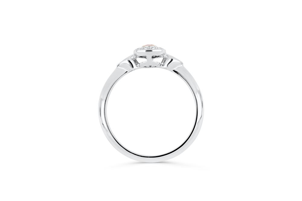 18k gold ring set with a centre FPP 0.087ct pear cut natural diamond