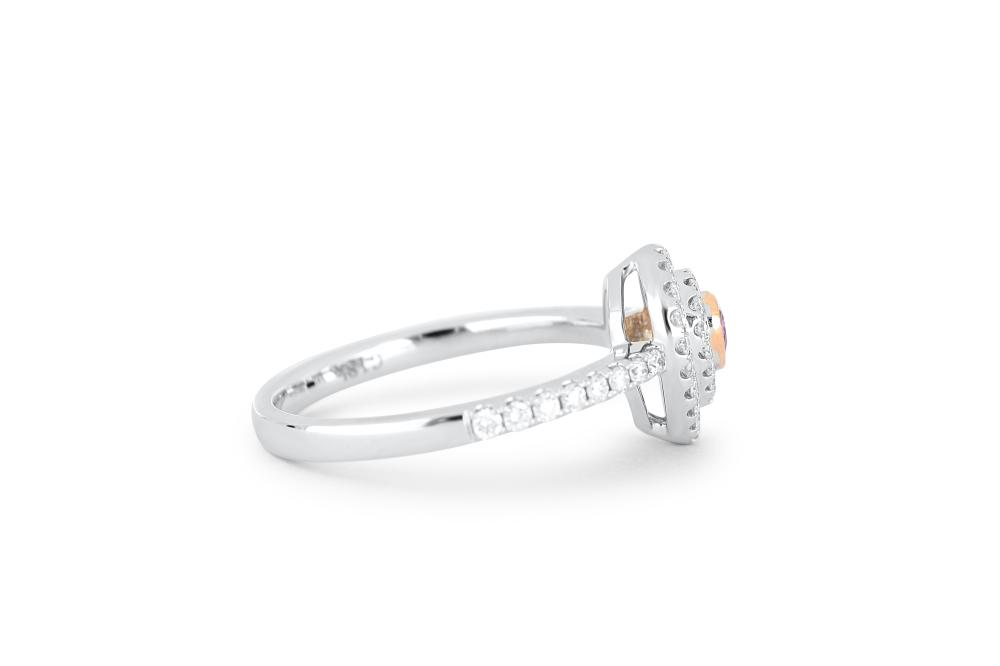 18k gold ring set with a centre FPP 0.077ct pear cut natural diamond