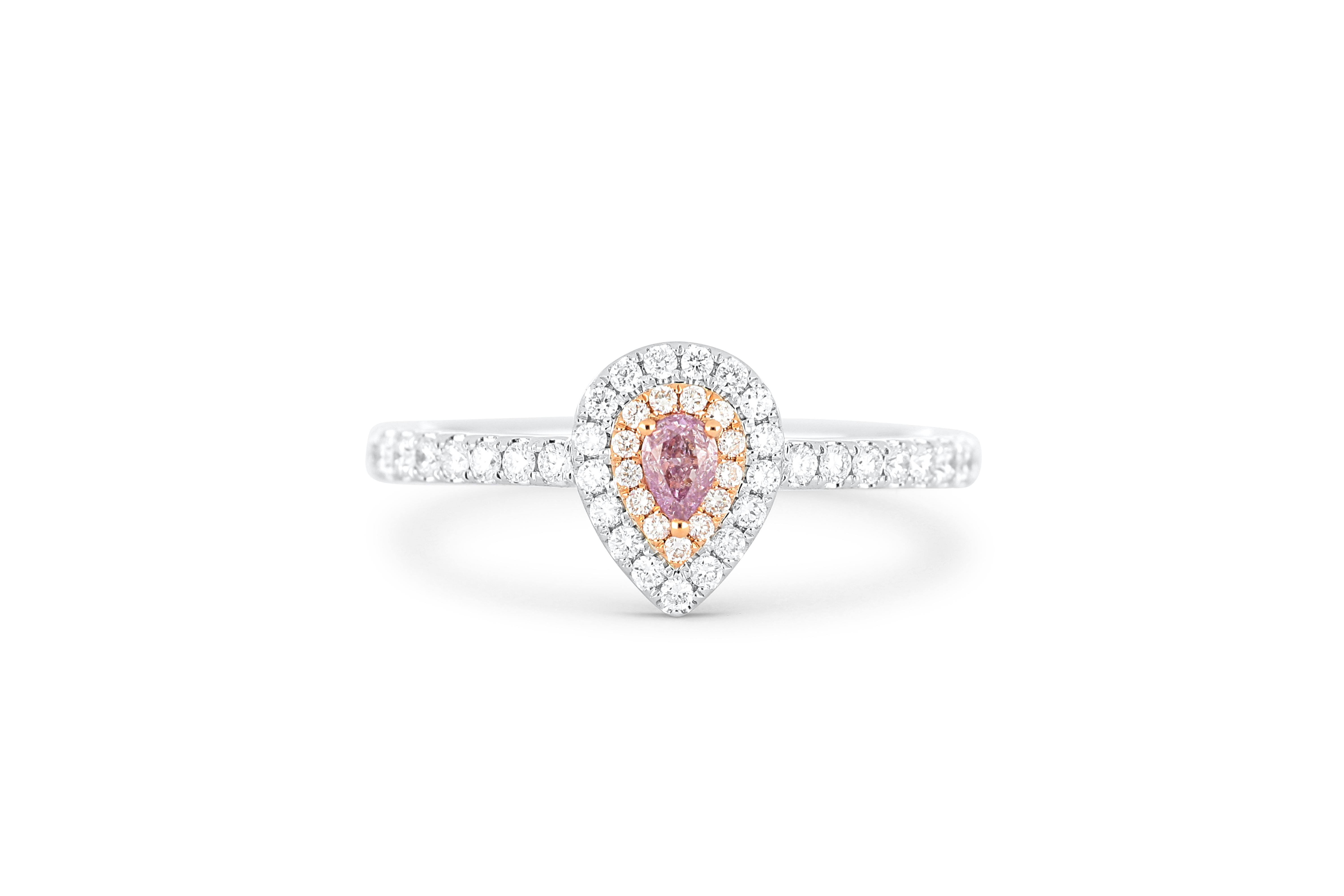 18k gold ring set with a centre FLPP 0.10ct pear cut natural diamond