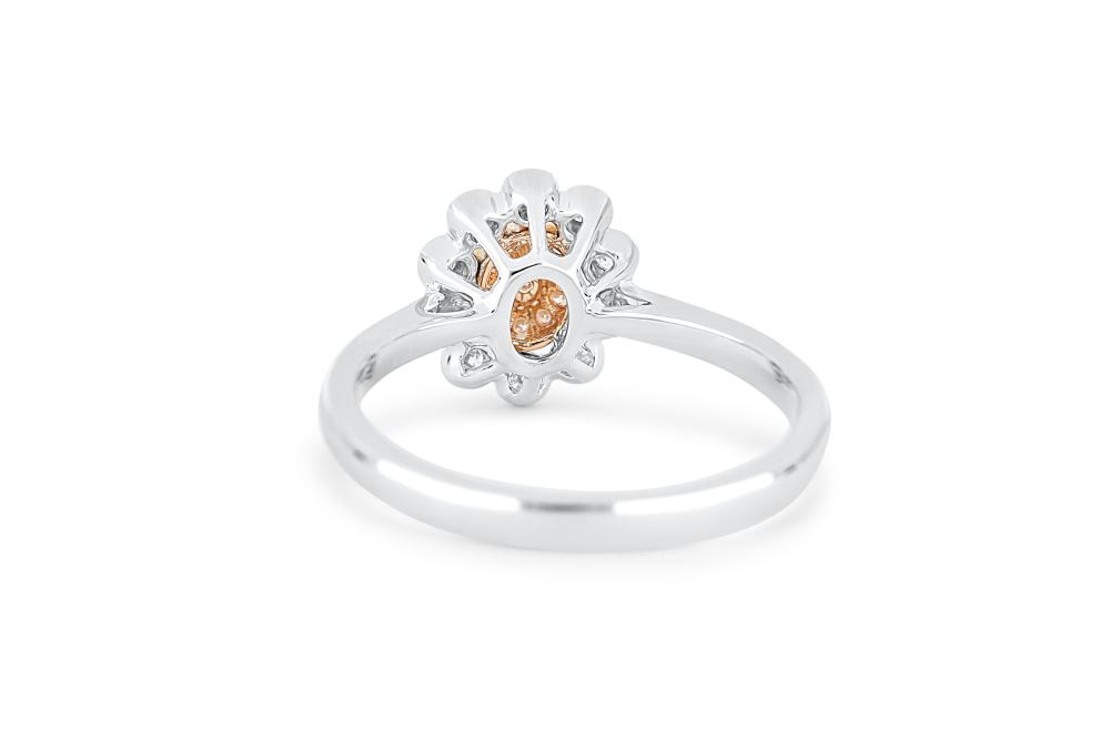 18k gold ring set with a centre FDPP 0.114ct oval cut natural diamond