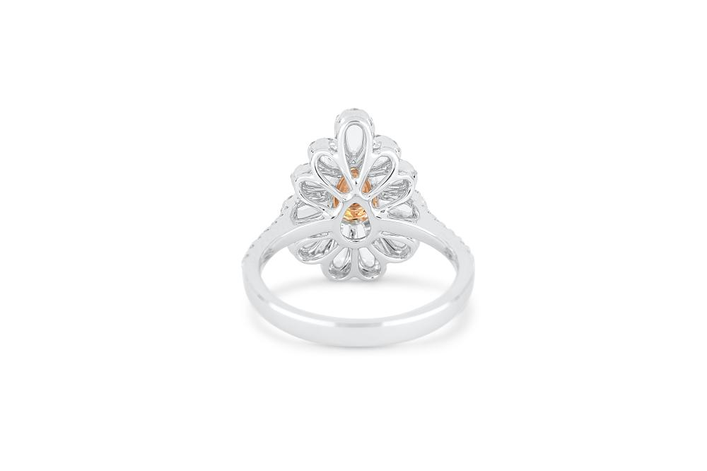 18k gold ring set with a centre FBP 0.134ct pear cut natural diamond