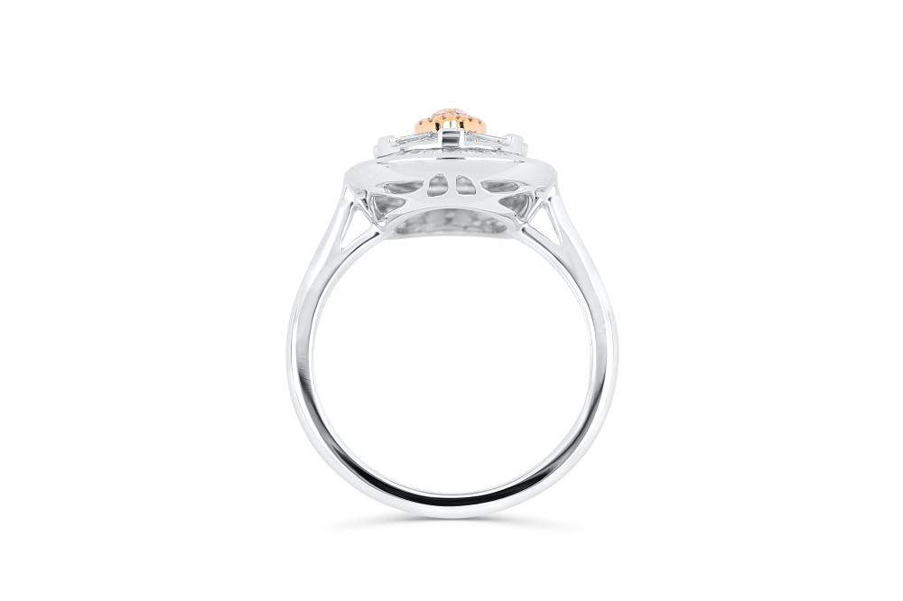 18k gold ring set with a centre FP Argyle 0.10ct pear cut natural diamond