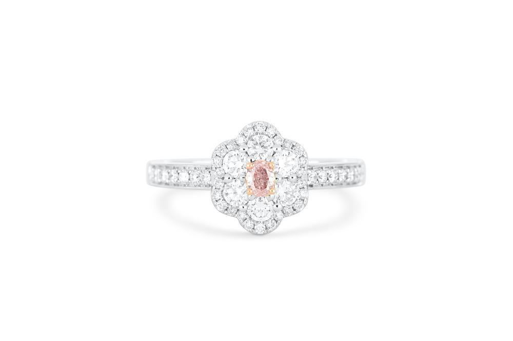 18k gold ring set with a centre FLP Argyle 0.088ct oval cut natural diamond