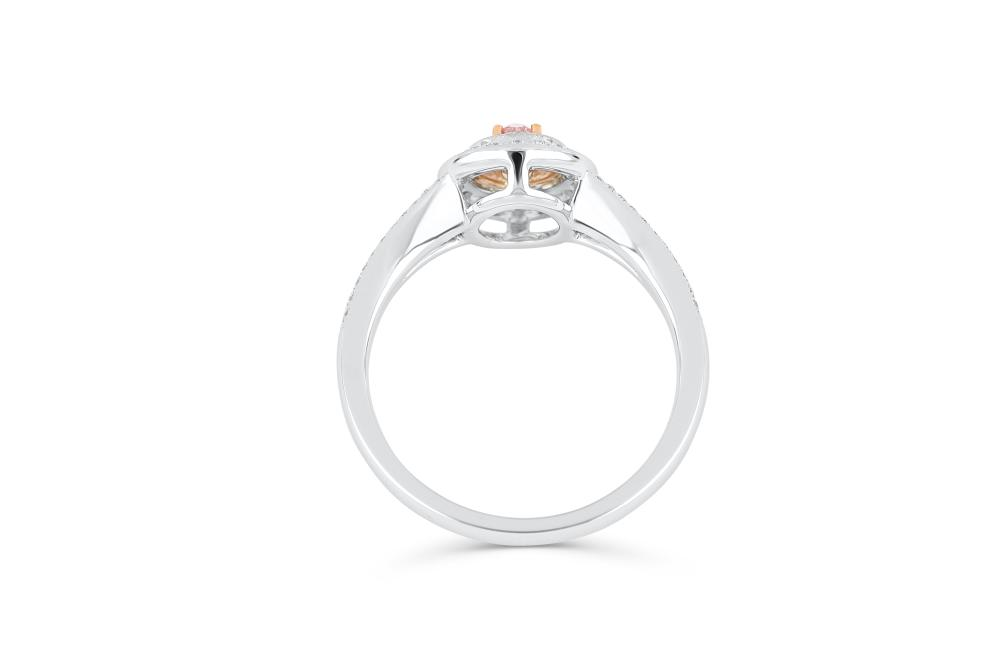 18k gold ring set with a centre FLP Argyle 0.183ct oval cut natural diamond