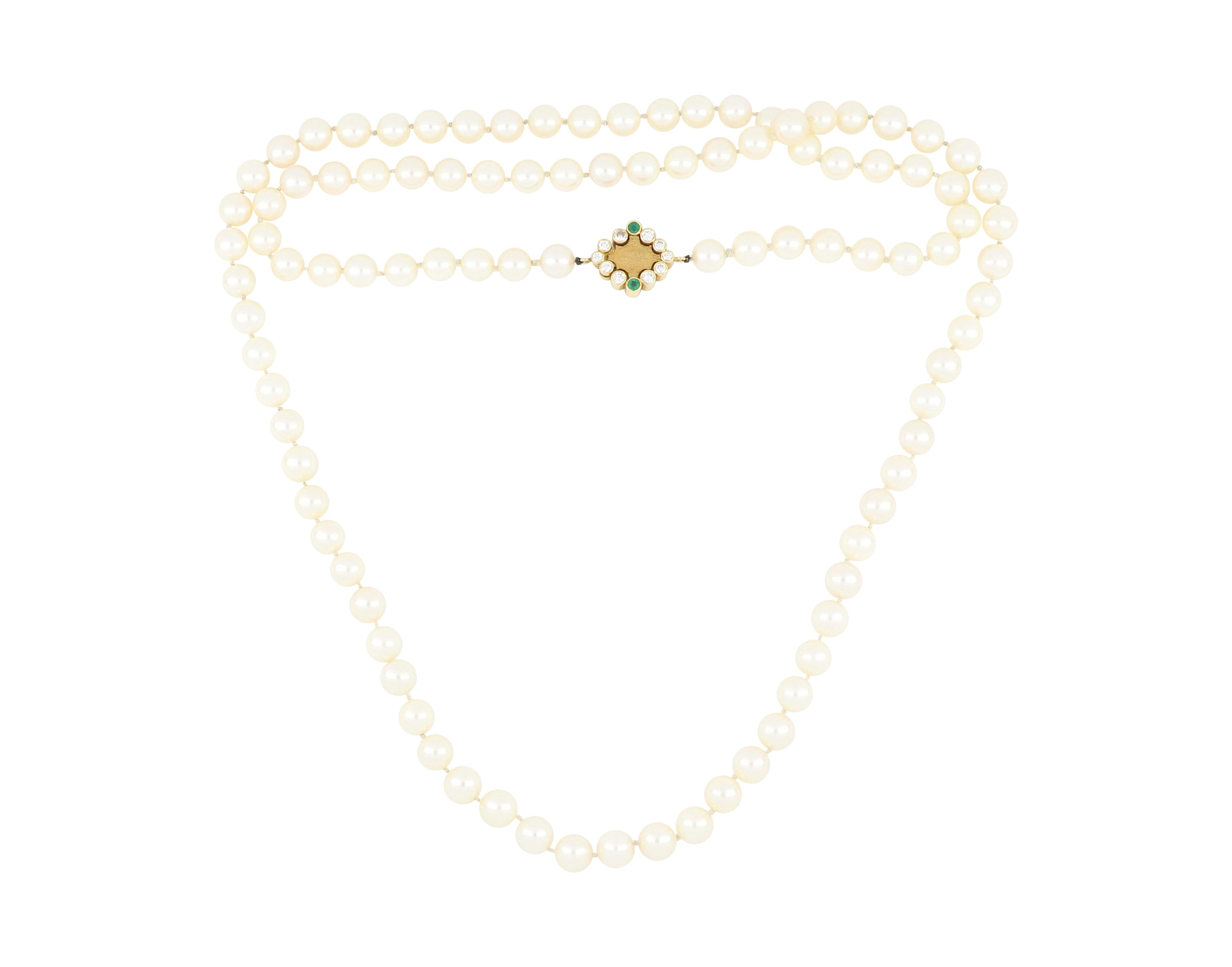 Cultured pearls necklace with gem set clasp