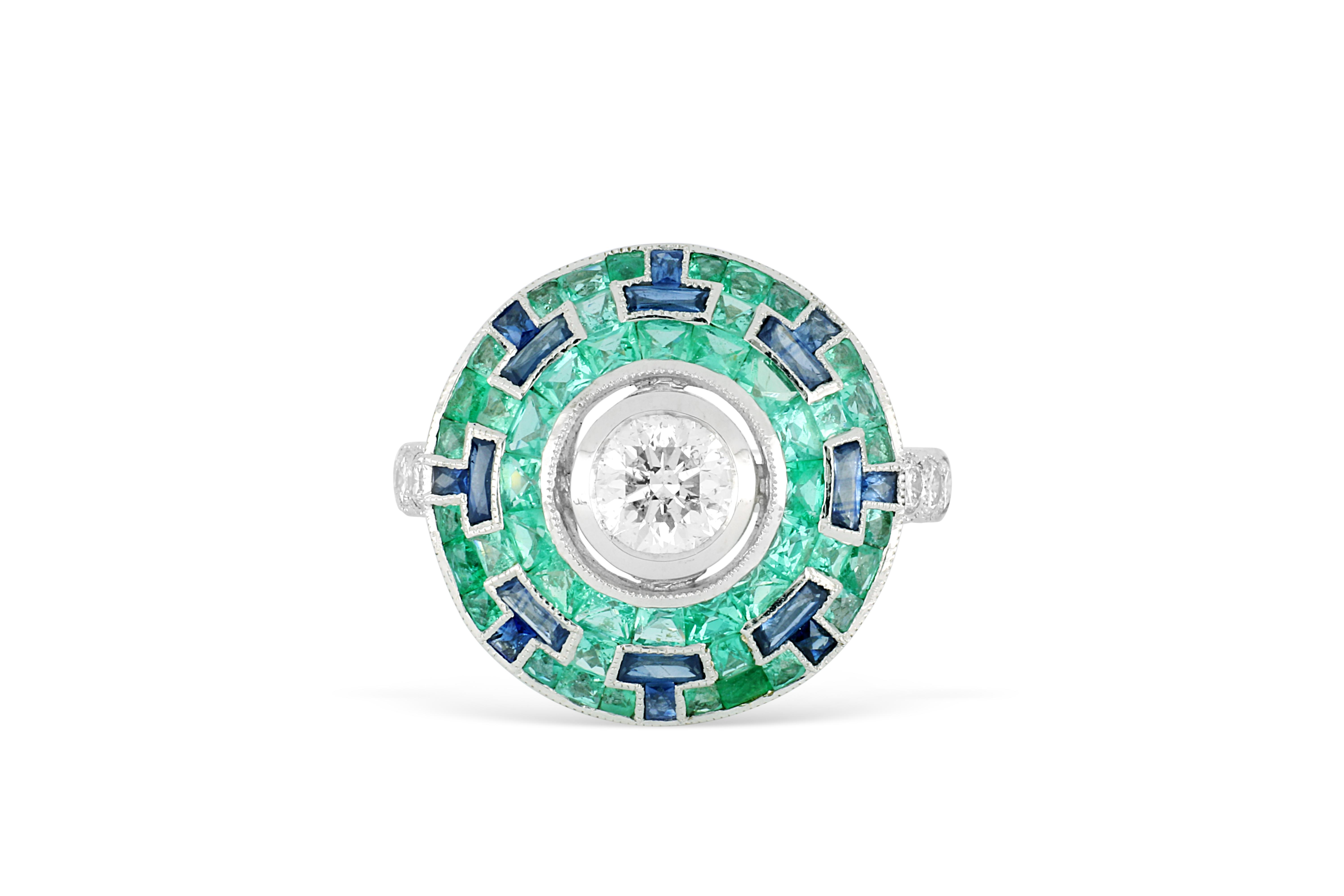 18k white gold ring set with 0.73ct diamond surrounded by emeralds & sapphires