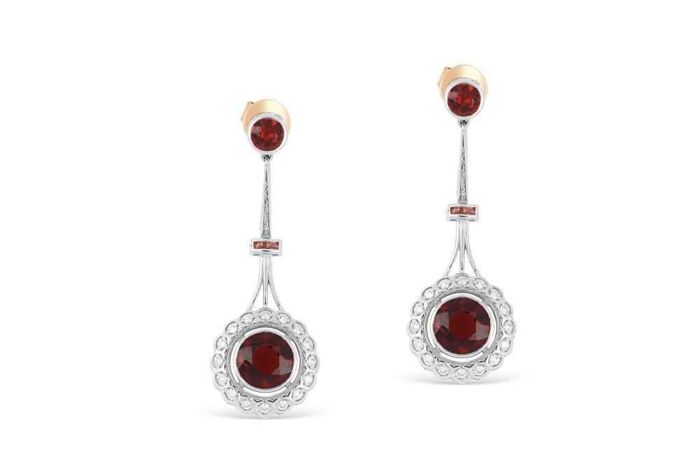 18k white gold earrings set with natural garnet & diamonds