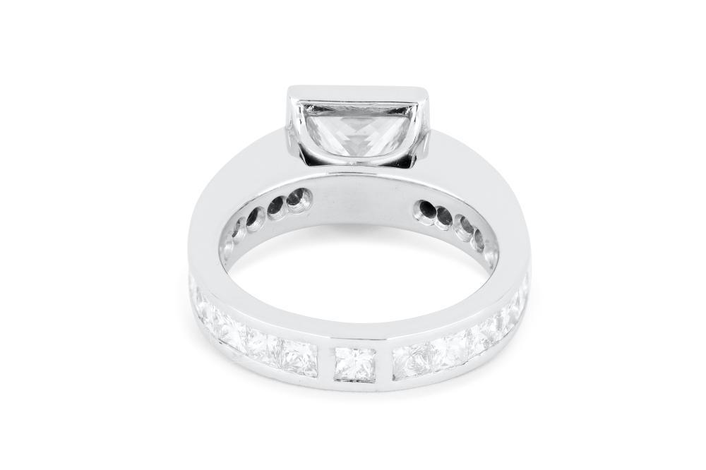 Handmade Platinum 3.01ct & 2.56ct princess cut diamond ring, 11.2 grams