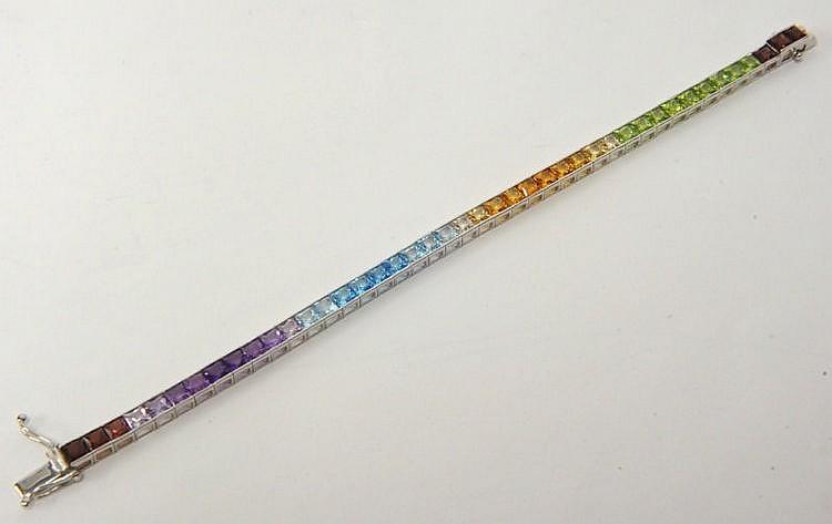 A 14K white gold line bracelet set with multi