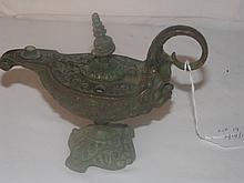 Bronze spirit lamp with faces