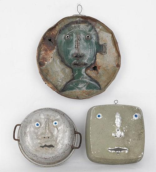 Three folk art pans and lids with punched faces,