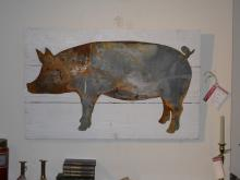 Metal Pig cut in metal and placed on old board