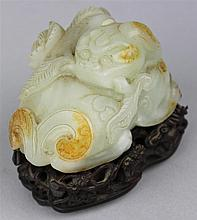 CHINESE WHITE AND RUSSET JADE CARVED QILONG