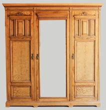 ARTS & CRAFTS FIGURED ASH THREE-PART ARMOIRE, LATE 19TH CENTURY