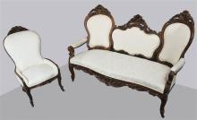 VICTORIAN CARVED AND UPHOLSTERED PARLOR SET WITH SETTEE AND ARM CHAIR