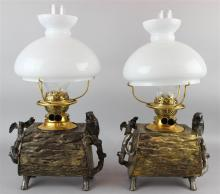 PAIR OF VICTORIAN BRASS AND PATINATED METAL 'OWL AND LOG' OIL LAMPS