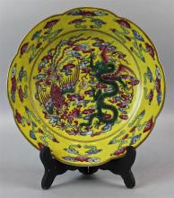 CHINESE FAMILLE ROSE ENAMELED YELLOW GROUND SCALLOP DISH, GUANGXU 6-CHARACTER MARK IN UNDERGLAZE BLUE