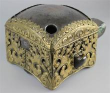 MONGOLIAN IRON ANVIL, 18TH CENTURY, WITH LATER GILT-BRONZE TRIM