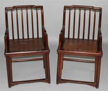 PAIR OF SPINDLE BACK JICHIMU ARM CHAIRS, QING DYNASTY (18TH/EARLY 19TH CENTURY)