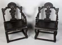 PAIR OF CHINESE CARVED AND STAINED HARDWOOD ARM CHAIRS