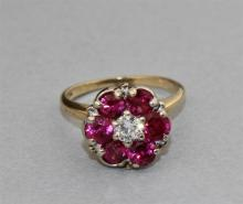 VINTAGE 14K YELLOW GOLD RING WITH A DIAMOND CENTER AND RUBY SURROUND