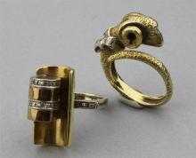 18K YELLOW GOLD CAPRICORN RING WITH DIAMONDS AND AN ITALIAN 18K YELLOW GOLD MODERN RING WITH DIAMONDS