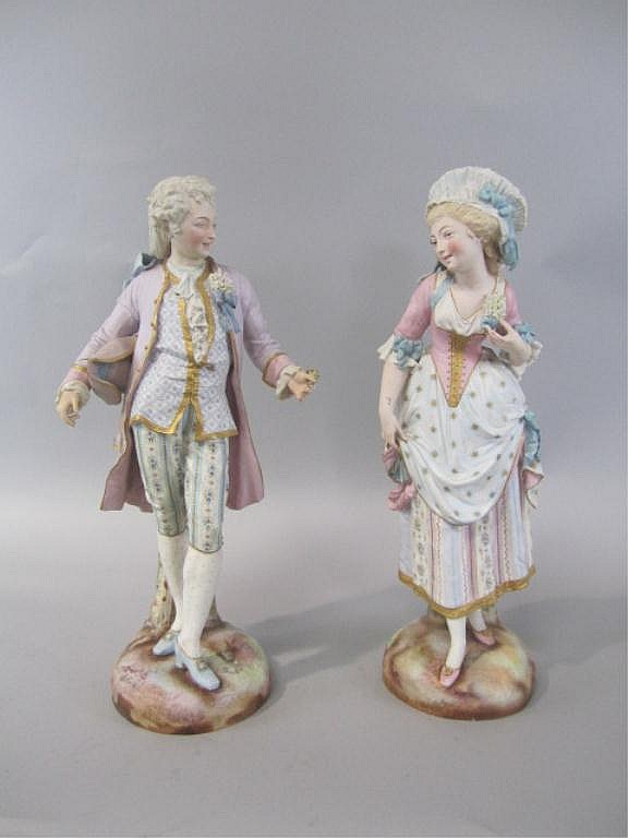 H25-20 PAIR OF LARGE BISQUE MAN & WOMAN FIGURES