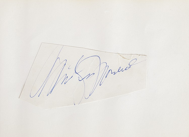 The Misfits autograph book with cast signatures including Marilyn Monroe and others.