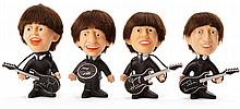 Set of (4) Beatles figures with replacement instruments.