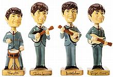 Vintage complete set of (4) The Beatles Bobbleheads figures.
