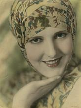 Oversize Jean Arthur hand-tinted photograph by Hommel.