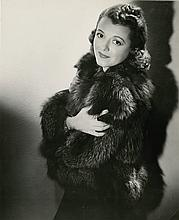 Oversize photograph of Janet Gaynor with snipe.